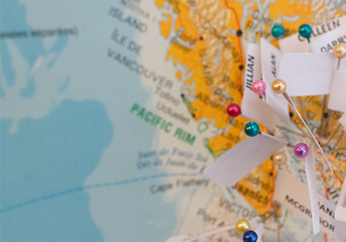 Students pinned flags to the various cities in Canada where they will be completing residencies.